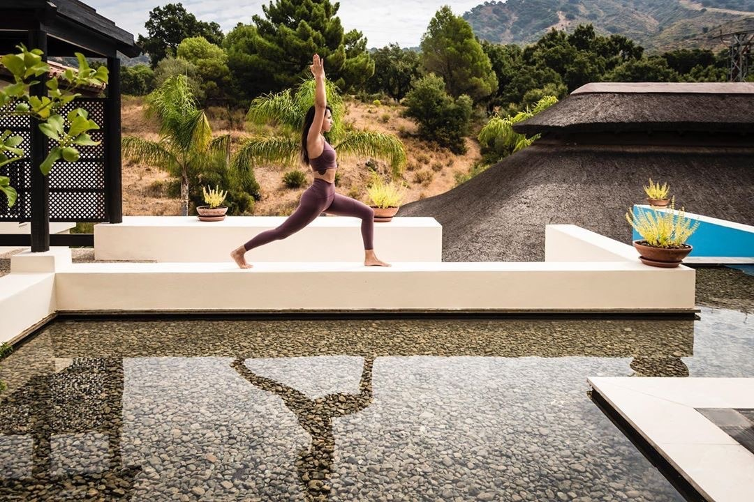 girl doing warrior pose at Yoga Retreat Spain